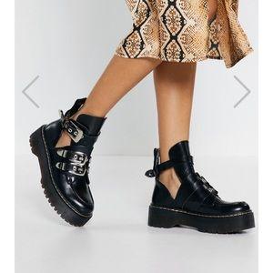 Edgy Black cutout boots